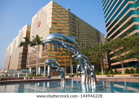 HONG KONG - MARCH 15: Unidentified man sits in front of a pool at The Royal Pacific Hotel and Towers in Kowloon, Hong Kong on March 15th, 2013  - stock photo