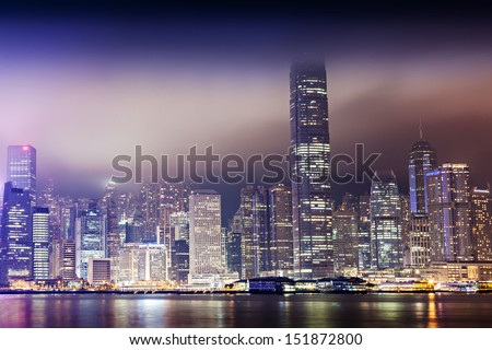 HONG KONG - MARCH 19: Victoria Harbor in Hong Kong on March, 19, 2013. The Victoria Harbour is world-famous for its stunning panoramic night view and skyline. - stock photo