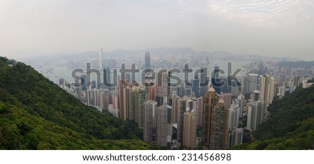 HONG KONG - MARCH 04: View of modern skyscrapers from Victoria peak on March 04, 2013 Hong Kong. Hong Kong is an international financial centre that has 112 buildings that stand taller than 180 metres - stock photo