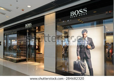HONG KONG - MAY 7, 2015: A HUGO BOSS store. Based in Hong Kong. It has 12,000 staff, 840 own stores and 2012 sales of EUR 2.3 billion in 129 countries. - stock photo