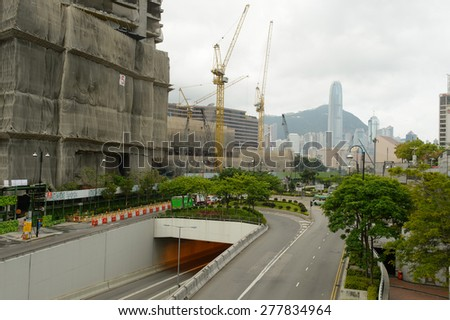 HONG KONG - MAY 06, 2015: building area in TST. Tsim Sha Tsui, often abbreviated as TST, is an urban area in southern Kowloon, Hong Kong.  - stock photo