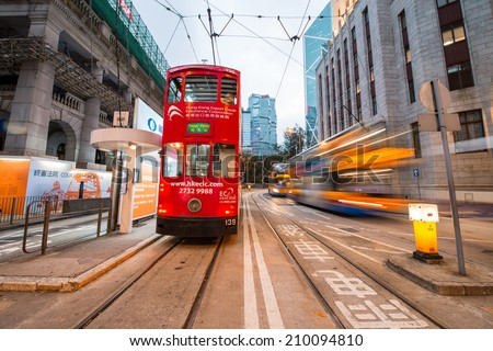 HONG KONG - MAY 12: Double-decker tram at night. Trams also a major tourist attraction and one of the most environmentally friendly ways of travelling in Hong Kong on May 12, 2014 in Hong Kong. - stock photo