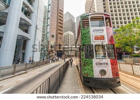 HONG KONG - MAY 11: Double-decker trams. Trams also a major tourist attraction and one of the most environmentally friendly ways of travelling in Hong Kong on May 11, 2014 in Hong Kong. - stock photo