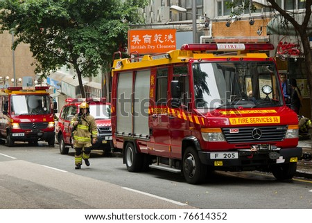 HONG KONG - MAY 02: Firemen and fire trucks arrive in morning on May 02, 2011 in Chai Wan, Hong Kong, China. A 19-year-old woman died and three people were injured in the fire. - stock photo