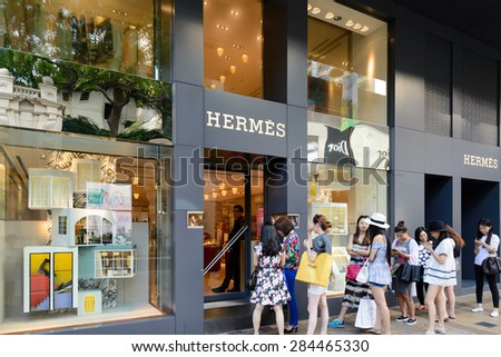 HONG KONG - MAY 7: Hermes Store in Hong Kong on May 7, 2014. Hermes is famous luxury brand existing since 1837. It had 2.4 billion EUR revenue in 2010. - stock photo