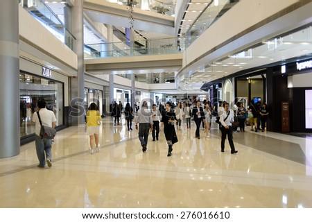 HONG KONG - MAY 05, 2015: Hong Kong shopping mall interior. Hong Kong shopping malls are some of the biggest and most impressive in the world - stock photo