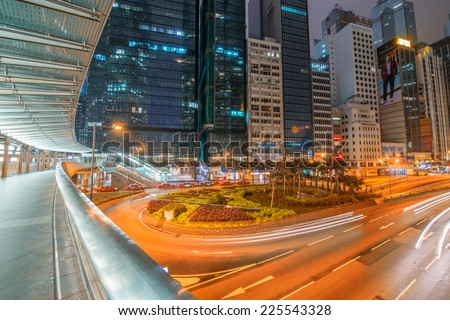 HONG KONG - MAY 8, 2014: Hong Kong skyline at night. The city is a major tourist attraction with more than 30 million visitors every year. - stock photo