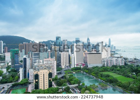 HONG KONG - MAY 7, 2014: Hong Kong skyline on a cloudy day. The city is a major tourist attraction with more than 30 million visitors every year. - stock photo
