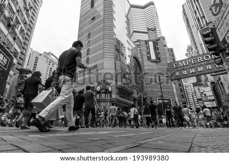 HONG KONG - MAY 18, 2014: People walking through busy streets close to Times Square in Causeway Bay are in Hong Kong. With 7M population, it is one of the most dense areas in the world.  - stock photo