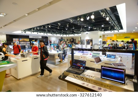 HONG KONG - MAY 17, 2015: shopping center interior. In Hong Kong a wide selection of clothing boutiques, designer flagship stores, restaurants, daily shows and exhibitions - stock photo