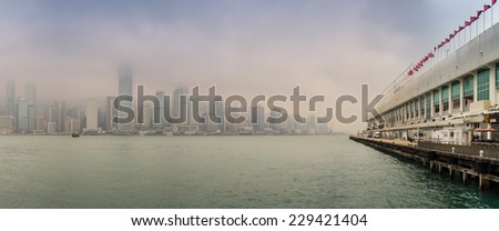 HONG KONG - MAY 12, 2014: Stunning panoramic view of Hong Kong Island from Kowloon port on a cloudy day. Last year HK hosted more than 54 million visitors, most of them from the mainland. - stock photo