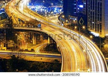 hong kong modern city High speed traffic and blurred light trails - stock photo