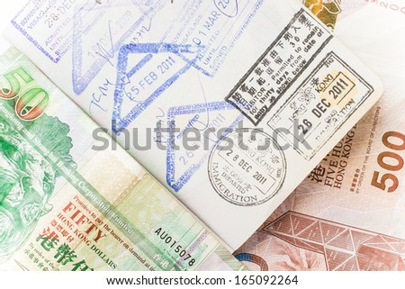 hong kong money and passport - stock photo