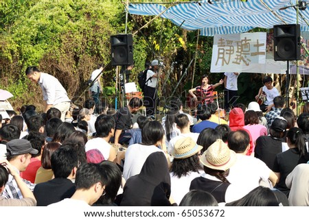 HONG KONG - NOV 14: A breath concert in Ma Shi Po to let the public know more about this village, a band plays music on Nov 14, 2010 in Hong Kong. A band appears in the open air with many audiences.