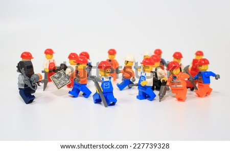 HONG KONG, NOV 2: A group of workers lego mini characters from different genation which are isolated on white in hong kong on 2 november 2014. Lego minifigure are the successful line in Lego products  - stock photo