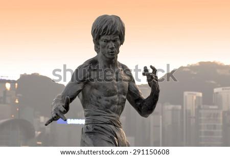 HONG KONG - NOV 16: Bruce Lee statue at the Avenue of Stars in Hong Kong on November 16. 2013 in China - stock photo