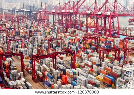 HONG KONG -Nov 24: Containers at Hong Kong commercial port on Nov 24, 2012 in Hong Kong, China. Hong Kong is one of several hub ports serving more than 240 million tonnes of cargo during the year. - stock photo