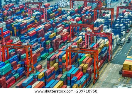 HONG KONG -Nov14: Containers at Hong Kong commercial port on Nov 14, 2014 in Hong Kong, China. Hong Kong is one of several hub ports serving more than 240 million tonnes of cargo during the year. - stock photo
