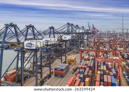 HONG KONG -Nov14: Containers at Hong Kong commercial port on Nov 14, 2014 in Hong Kong, China. Hong Kong is one of several hub ports serving more than 240 million tonnes of cargo during the year.