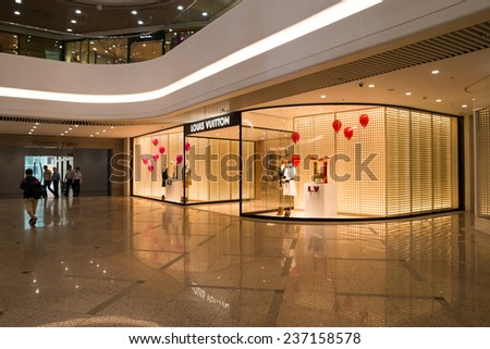 HONG KONG - NOV 19: Louis Vuitton shop on Nov 19, 2014 in Hong Kong. Forbes claims Louis Vuitton was the most powerful luxury brand in the world in 2008 with $19.4bn USD value. LV was founded in 1854 - stock photo