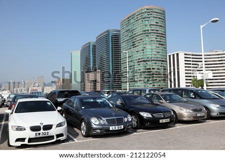 HONG KONG - NOV 28: Luxury cars in parking lot in the city of Hong Kong. November 28, 2010 in Hong Kong, China - stock photo