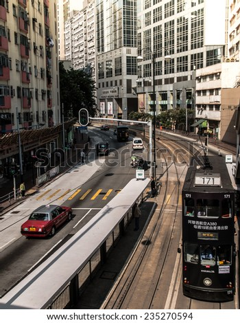 HONG KONG - NOV 19: Unidentified people use city tram on Nov 19, 2014. Hong Kong tram is the only system in the world run with double deckers and one of the main tourist attractions. - stock photo