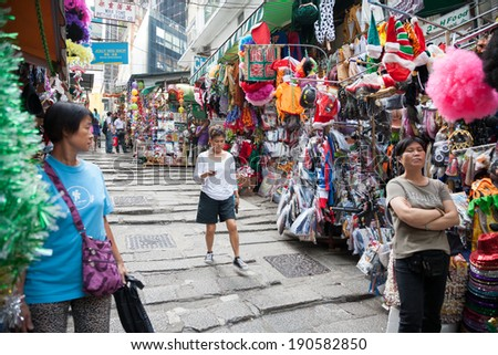 HONG KONG - NOVEMBER 14, 2012: Trading pedestrian street in Central Hong Kong. These streets are popular with tourists and locals, small traders It is proposed various items for everyday life.