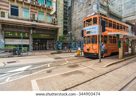 HONG KONG - OCT 25: Double-decker trams. Trams also a major tourist attraction and one of the most environmentally friendly ways of travelling in Hong Kong on October 25, 2015 in Hong Kong.