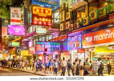 HONG KONG - OCT 18: Neon lights on Tsim Sha Tsui street on October 18, 2015. Tsim Sha Tsui street is a very popular shopping place in Hong Kong. - stock photo