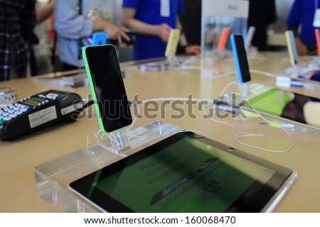 HONG KONG - OCT 25: New iphone 5 c display in apple store in HongKong on October 25, 2013 . Apple's reportedly cutting production of its low cost iPhone 5C, but raising production for  iPhone 5S - stock photo
