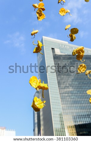 HONG KONG, OCT 2014: People hang the yellow umbrella, symbol of revolution in occupy protest during Umbrella Revolution. - stock photo