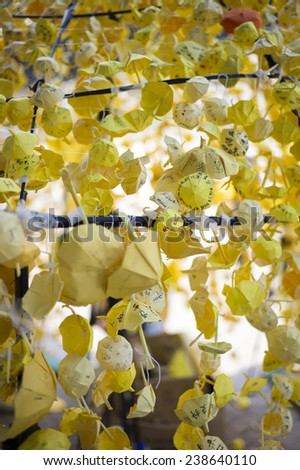 HONG KONG - OCT 15: People hang up the yellow paper umbrealla and make wish during Occupy Central movement in Admiralty in Hong Kong on October 15 2014.  - stock photo