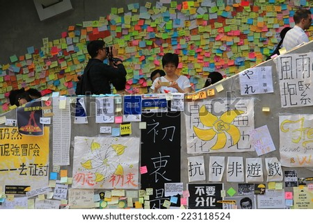 HONG KONG,OCT. 13:people is still insist on ocuppy protest  in Admiralty on 13 october 2014. People involved the Umbrella revolution after two week, they leave comment and the symbol yellow umbrella