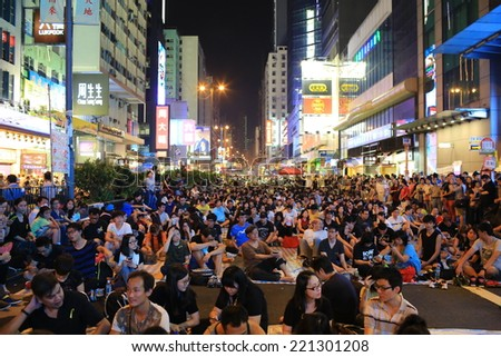 HONG KONG, OCT 1: protesters occupy the road in Mongkok on 1 October 2014. after riot police fire tear shell to the peaceful protesters on 28 sept, more people join the protest - stock photo