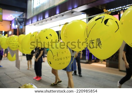 HONG KONG,OCT.1: protesters occupy the street  in Causeway bay on 1 October 2014. after riot police fire tear shell to the peaceful protesters, people join the protest - stock photo