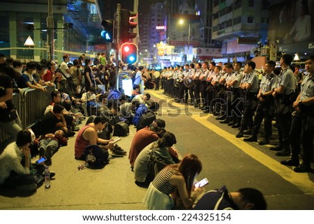 HONG KONG, OCT.17: tension between the police and protesters in Mong Kok on 17 October 2014. during Umbrella revolution, police clear the roadblock, but one day after protester occupy the road again - stock photo