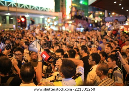 HONG KONG, OCT 3: tension between the protesters and government supporter, also some gangsters inside in Mongkok on 3 Oct. 2014.after police fire tear shell in peaceful protest,people join the protest - stock photo