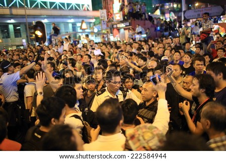 HONG KONG, OCT 1: the tension between the protesters and government supporter in Mongkok on 1 October 2014.after police fire tear shell to the peaceful protesters, more people join the protest - stock photo