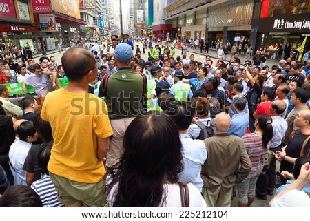 HONG KONG, OCT 8: Umbrella Revolution in Mong Kok on 8 October 2014.  Hong Kong people are fighting for a real universal suffrage for the next chief executive election. - stock photo