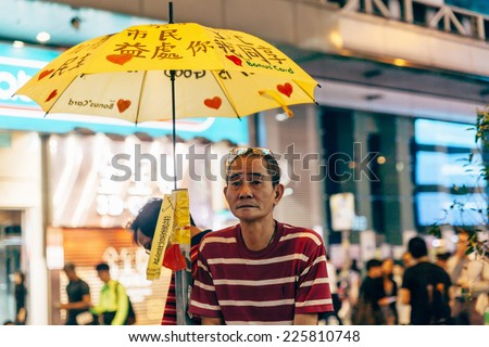 HONG KONG, OCT 23: Umbrella Revolution in Mongkok on 23 October 2014. Hong Kong people are fighting for a real universal suffrage for the next chief executive election. - stock photo