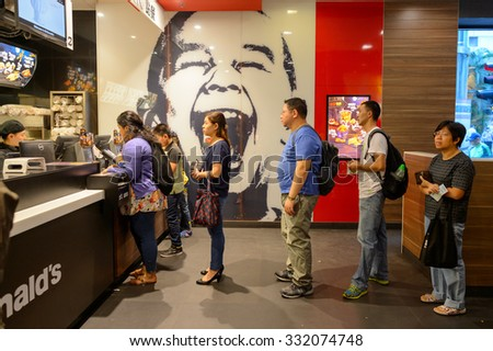 HONG KONG - OCTOBER 25, 2015: interior of McDonald's restaurant. McDonald's primarily sells hamburgers, cheeseburgers, chicken, french fries, breakfast items, soft drinks, milkshakes, and desserts - stock photo