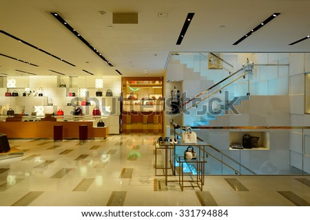 HONG KONG - OCTOBER 25, 2015: interior of the Louis Vuitton.  Louis Vuitton, or shortened to LV, is a French fashion house founded in 1854 by Louis Vuitton. - stock photo