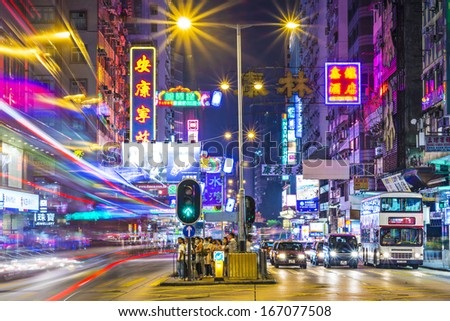 HONG KONG - OCTOBER 8: Traffic and pedestrians on Nathan Road October 8, 2012 in Hong Kong, China. Nathan Road is the main thoroughfare through Kowloon.