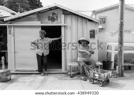 HONG KONG - OCTOBER 03, 2015: Two unidentified women in front of small house.