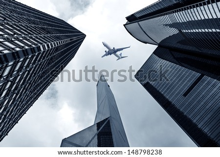 Hong Kong's skyscrapers and airplanes on sky - stock photo