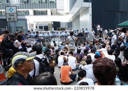HONG KONG - SEP.27: After 12 hours of the launch of  Reclaim of the Civic Square' protest , thousands of protesters stay around the headquarter of Hong Kong government at Tamar to support the students