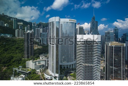 HONG KONG - SEP 15: Hotel and commercial buildings in Central on September 15, 2014 in Hong Kong. With a population of seven million, The city is one of the most densely populated in the world.  - stock photo