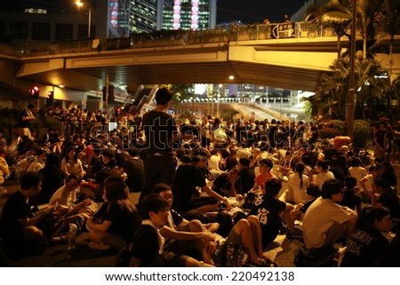 HONG KONG, SEPT.29: Crowd of protesters occupy the road in Admiralty on 29 September 2014. after riot police fire tear shell to the peaceful protesters on 28 sept, more people join the protest - stock photo