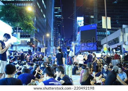HONG KONG, SEPT.29: Crowd of protesters occupy the road in Central on 29 September 2014. after riot police fire tear shell to the peaceful protesters on 28 sept, more people join the protest - stock photo