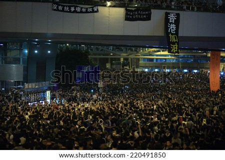 HONG KONG, SEPT.29: Crowd of protesters wave the mobile  in Admiralty on 29 September 2014. after riot police fire tear shell to the peaceful protesters on 28 sept, more people join the protest - stock photo